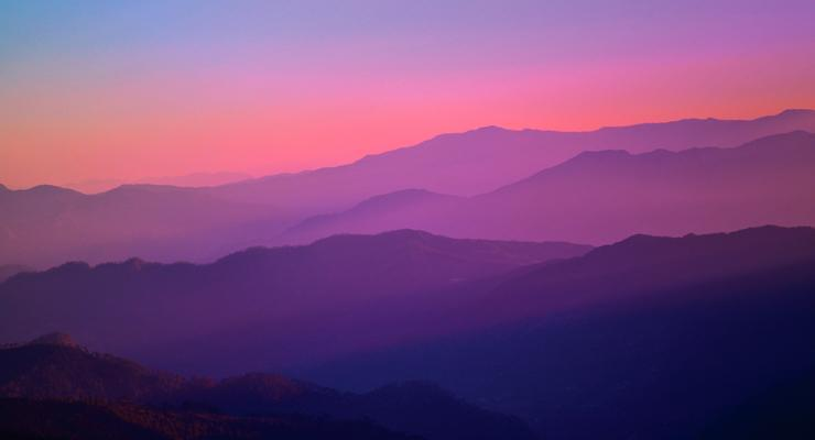 mountain range at sunset